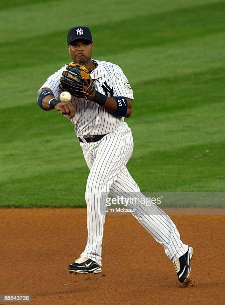 Robinson Cano of the New York Yankees throws to first base for an out against the Washington Nationals on June 17 2009 at Yankee Stadium in the Bronx...