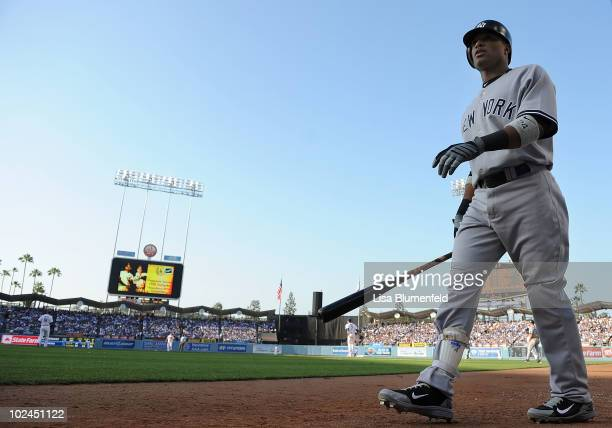Robinson Cano of the New York Yankees walks on deck during the game against the Los Angeles Dodgers at Dodger Stadium on June 26 2010 in Los Angeles...