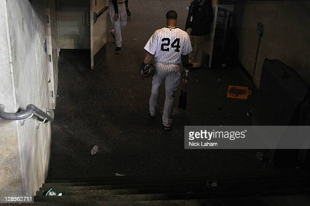 Robinson Cano of the New York Yankees walks out of the dugout dejected towards the locker room after they lost 32 against the Detroit Tigers during...