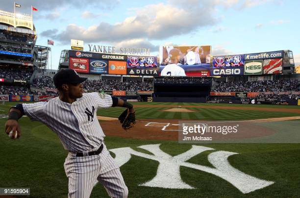 Robinson Cano of the New York Yankees warms up before playing the Minnesota Twins in Game One of the ALDS during the 2009 MLB Playoffs at Yankee...