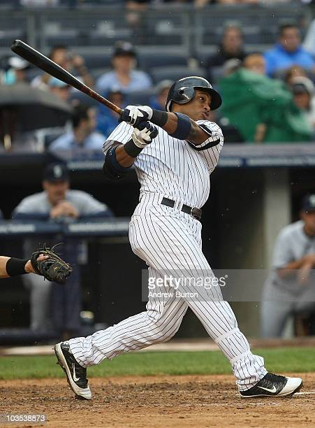 Robinson Cano of the New York Yankees watches his grand slam home run against the Seattle Mariners on August 22 2010 at Yankee Stadium in the Bronx...
