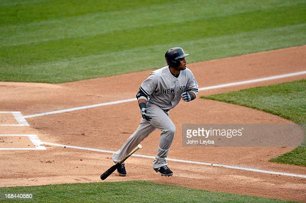Robinson Cano of the New York Yankees watches his hit sail over the wall for a home run in the fifth inning off of Adam Ottavino of the Colorado...