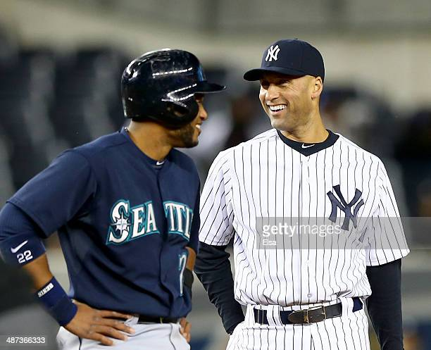 Robinson Cano of the Seattle Mariners and Derek Jeter of the New York Yankees talks as Cano is on second in the seventh inning on April 29 2014 at...