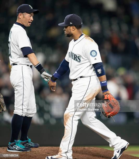 Robinson Cano of the Seattle Mariners and Ichiro Suzuki of the Seattle Mariners celebrate after a game against the Baltimore Orioles at Safeco Field...