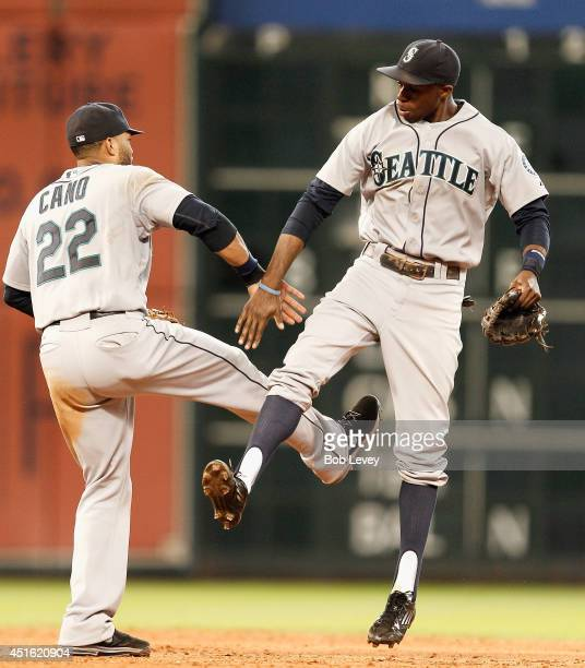 Robinson Cano of the Seattle Mariners and James Jones celebrate after the final out as the Seattle Mariners defeated the Houston Astros 52 at Minute...