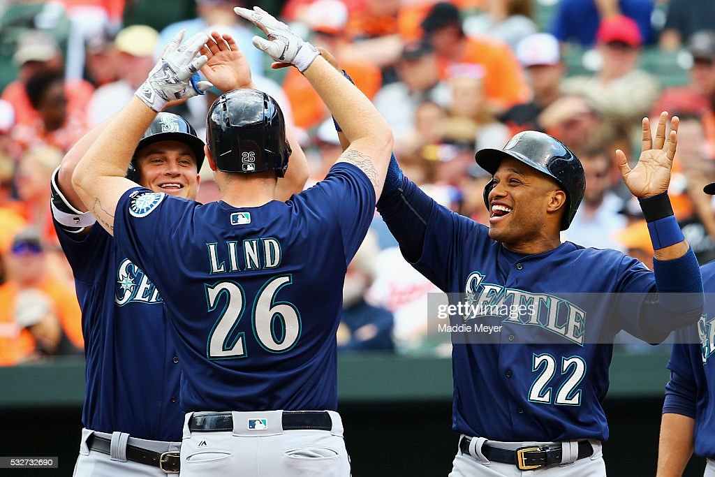 Robinson Cano #22 of the Seattle Mariners and Kyle Seager #15 congratulate Adam Lind #26 at home plate after he hit a three runhomer during the sixth inning against the Baltimore Orioles on May 19, 2016 in Baltimore, Maryland.