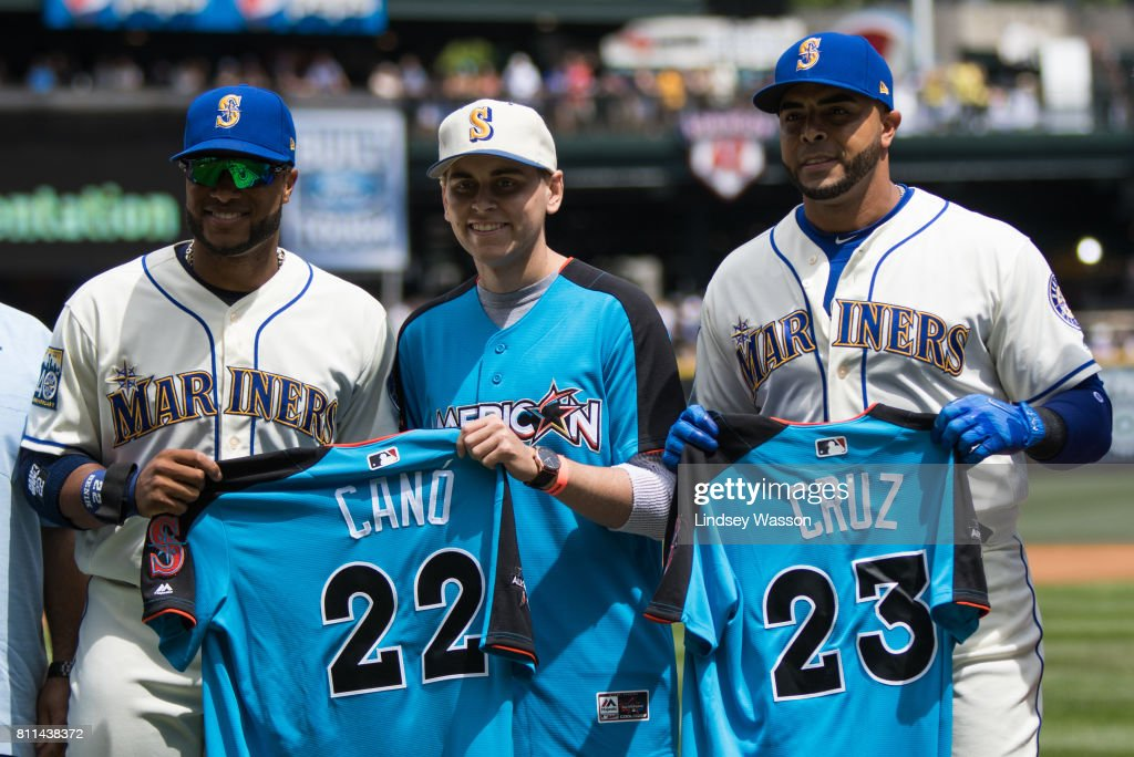 Robinson Cano #22 of the Seattle Mariners and Nelson Cruz #23 of the Seattle Mariners pose with their All Star Game jerseys before the game against the Oakland Athletics at Safeco Field on July 9, 2017 in Seattle, Washington.