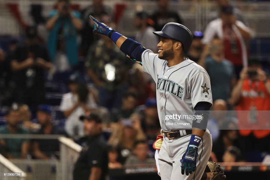 Robinson Cano #22 of the Seattle Mariners and the American League celebrates hitting a home run in the tenth inning against the National League during the 88th MLB All-Star Game at Marlins Park on July 11, 2017 in Miami, Florida.