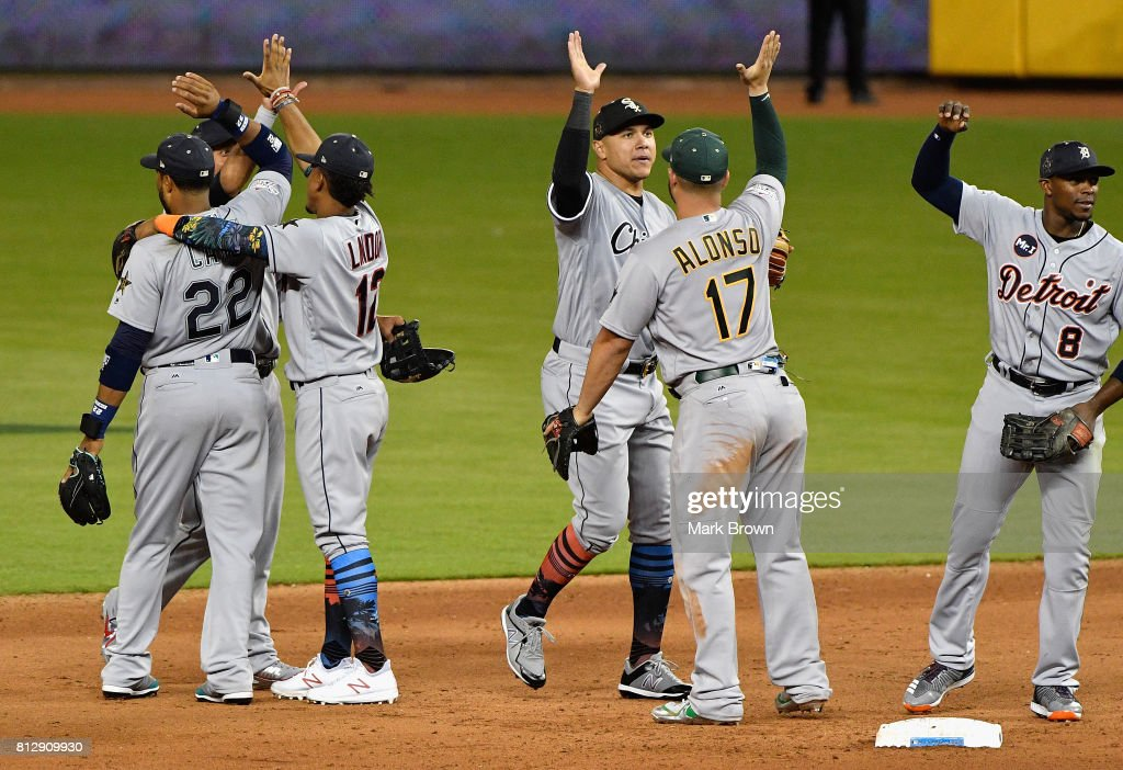 Robinson Cano #22 of the Seattle Mariners and the American League celebrates with teammates after they defeated the National League 2 to 1 during the 88th MLB All-Star Game at Marlins Park on July 11, 2017 in Miami, Florida.