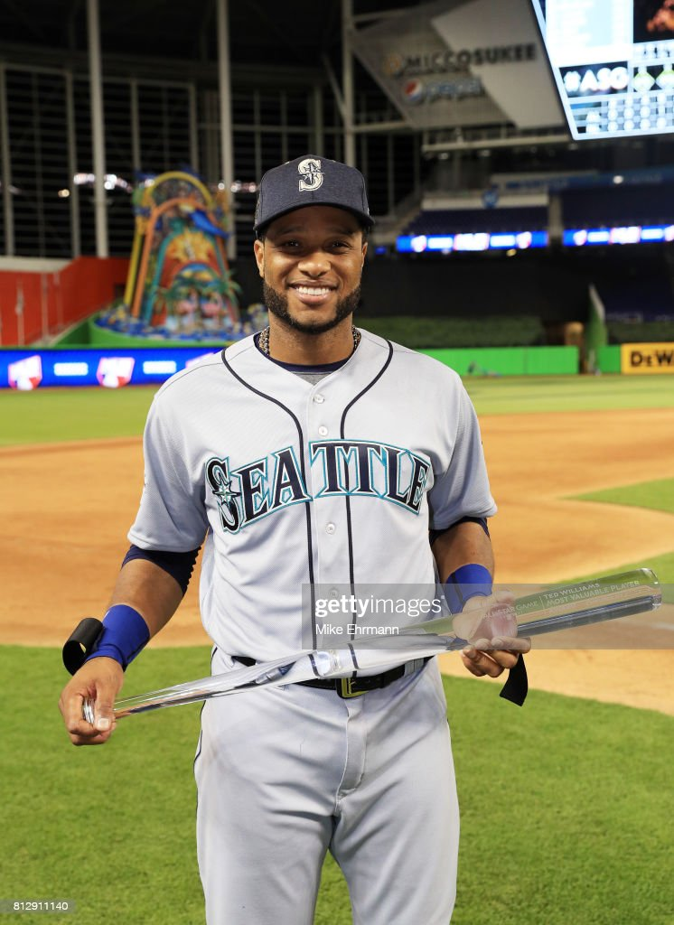 Robinson Cano #22 of the Seattle Mariners and the American League celebrates with the Major League Baseball All-Star Game Most Valuable Player Award after they defeated the National League 2 to 1 during the 88th MLB All-Star Game at Marlins Park on July 11, 2017 in Miami, Florida.