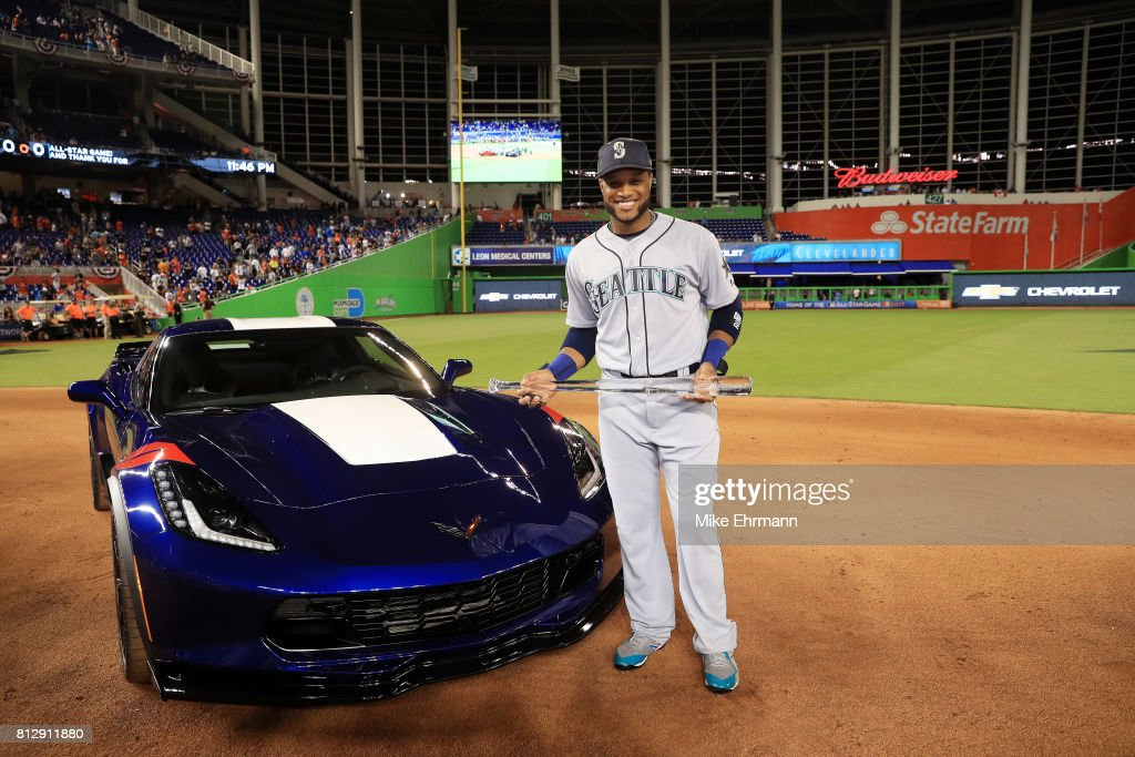 Robinson Cano #22 of the Seattle Mariners and the American League celebrates with the Major League Baseball All-Star Game Most Valuable Player Award after defeating the National League 2-1 in the 88th MLB All-Star Game at Marlins Park on July 11, 2017 in Miami, Florida.