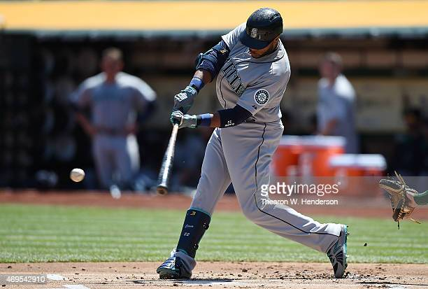 Robinson Cano of the Seattle Mariners bats against the Oakland Athletics in the top of the firs inning at Oco Coliseum on April 12 2015 in Oakland...