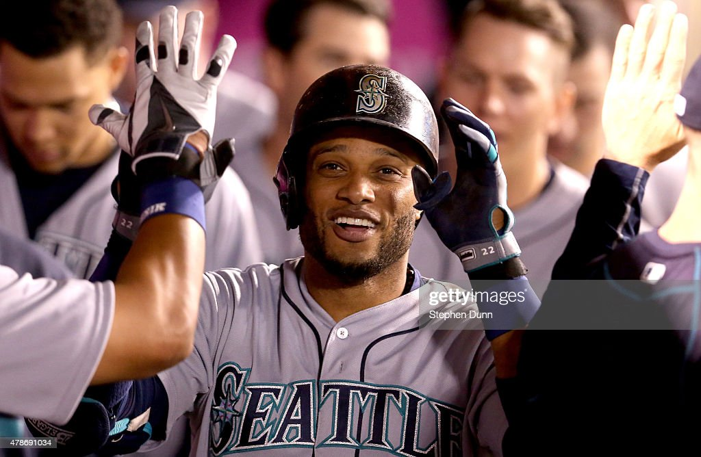 Robinson Cano #22 of the Seattle Mariners celebrates in the dugout after hitting a solo home run in the eighth inning against the Los Angeles Angels of Anaheim at Angel Stadium of Anaheim on June 26, 2015 in Anaheim, California.
