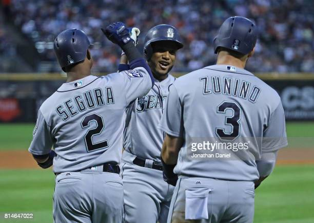 Robinson Cano of the Seattle Mariners celebrates with Jean Segura and Mike Zunino after hitting a three run home run in the 3rd inning against the...