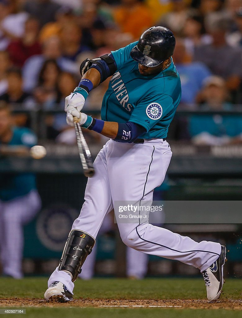 Robinson Cano #22 of the Seattle Mariners doubles in the seventh inning against the New York Mets at Safeco Field on July 21, 2014 in Seattle, Washington.