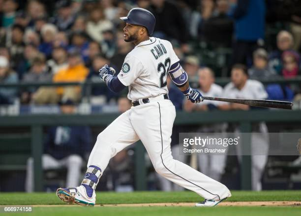 Robinson Cano of the Seattle Mariners hits a double off of Charlie Morton of the Houston Astros during the first inning of the home opener at Safeco...
