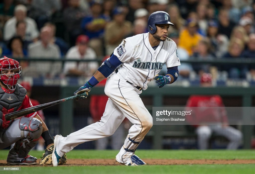 Robinson Cano #22 of the Seattle Mariners hits a double off of relief pitcher Deolis Guerra #54 of the Los Angeles Angels of Anaheim during the sixth inning of a game at Safeco Field on September 9, 2017 in Seattle, Washington. The Mariners won the game 8-1.