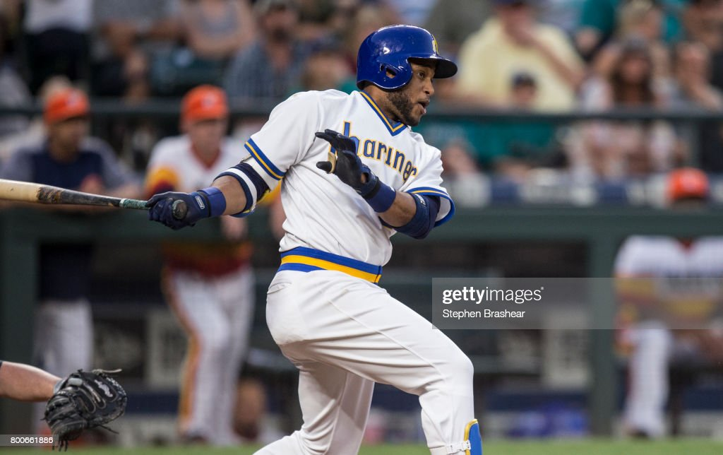 Robinson Cano #22 of the Seattle Mariners hits a RBI-single off of relief pitcher Will Harris #36 of the Houston Astros that scored Carlos Ruiz #52 of the Seattle Mariners during the sixth inning of a game at Safeco Field on June 24, 2017 in Seattle, Washington.