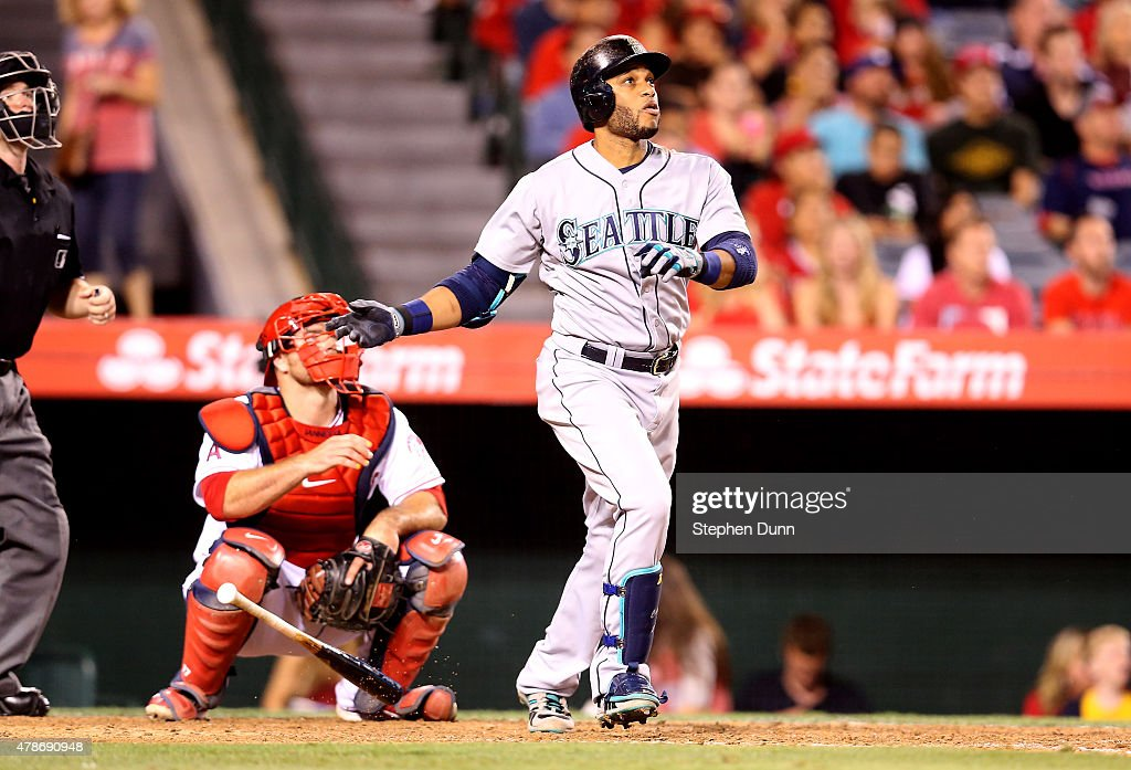 Robinson Cano #22 of the Seattle Mariners hits a solo home run in the eighth inning against the Los Angeles Angels of Anaheim at Angel Stadium of Anaheim on June 26, 2015 in Anaheim, California.