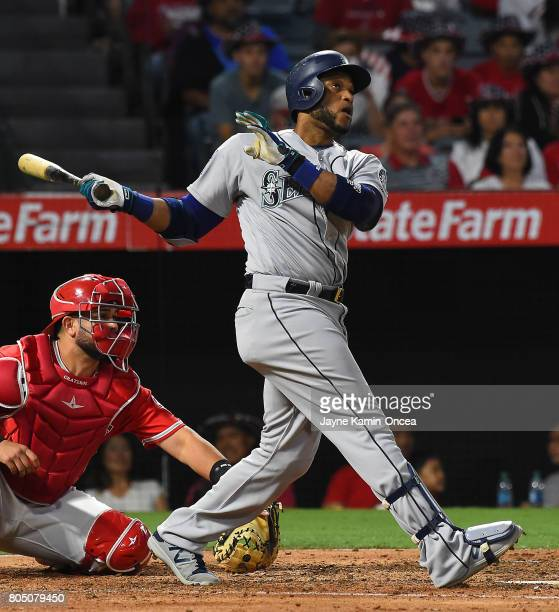 Robinson Cano of the Seattle Mariners hits a three run home run in the fifth inning of the game against the Los Angeles Angels of Anaheim at Angel...