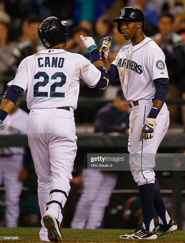 Robinson Cano #22 of the Seattle Mariners is congratulated by James Jones #99 after hitting a two-run home run in the ninth inning against the New York Yankees at Safeco Field on June 11, 2014 in Seattle, Washington. The Yankees defeated the Mariners 4-2.