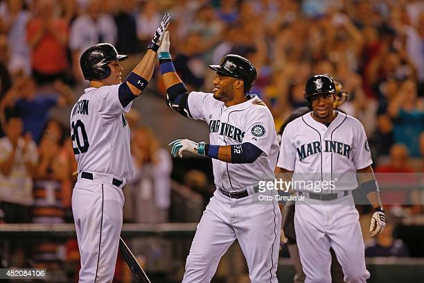 Robinson Cano of the Seattle Mariners is congratulated by Logan Morrison after hitting a threerun home run in the eighth inning against the Oakland...