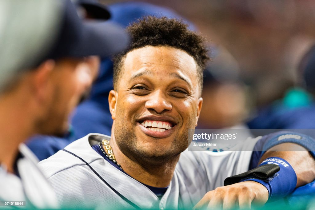 Robinson Cano #22 of the Seattle Mariners jokes with teammates during the fifth inning against the Cleveland Indians at Progressive Field on April 28, 2017 in Cleveland, Ohio. The Mariners defeated the Indians 3-1.