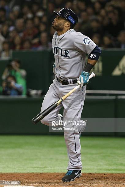 Robinson Cano of the Seattle Mariners reacts after being hit by a pitch in the seventh inning during the game three of Samurai Japan and MLB All...
