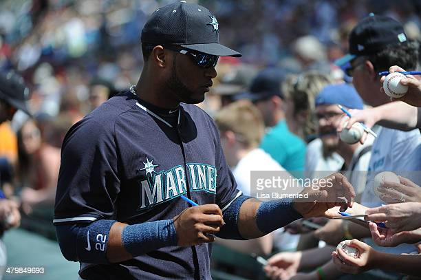 Robinson Cano of the Seattle Mariners signs autographs for fans before the game against the Chicago Cubs at Cubs Park on March 20 2014 in Mesa Arizona