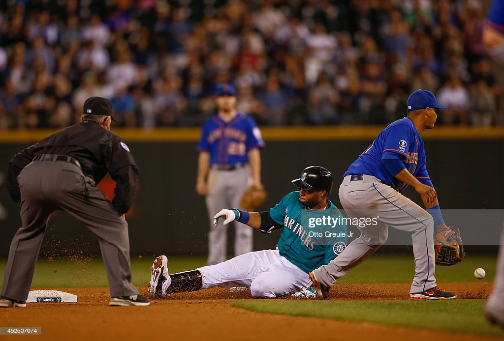Robinson Cano #22 of the Seattle Mariners slides into second with a double as shortstop Ruben Tejada #11 of the New York Mets takes the throw in the seventh inning at Safeco Field on July 21, 2014 in Seattle, Washington.