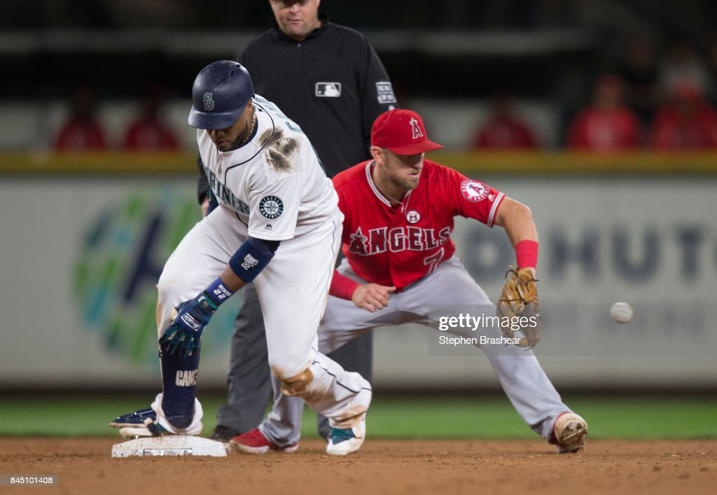 Robinson Cano #22 of the Seattle Mariners slides safely into second base before shortstop Cliff Pennington #7 of the Los Angeles Angels of Anaheim can catch the ball and make a tag during the sixth inning of game at Safeco Field on September 9, 2017 in Seattle, Washington.