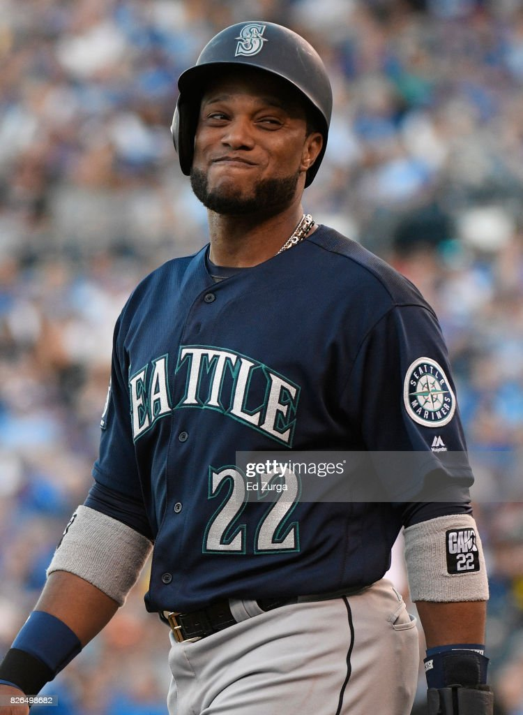 Robinson Cano #22 of the Seattle Mariners smiles at teammates as he walks back to third during a game Kansas City Royals in the first inning at Kauffman Stadium on August 4, 2017 in Kansas City, Missouri.