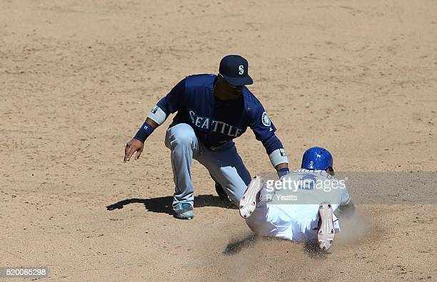 Robinson Cano of the Seattle Mariners tags out Delino DeShields of the Texas Rangers in the eighth inning at Global Life Park in Arlington on April 6...