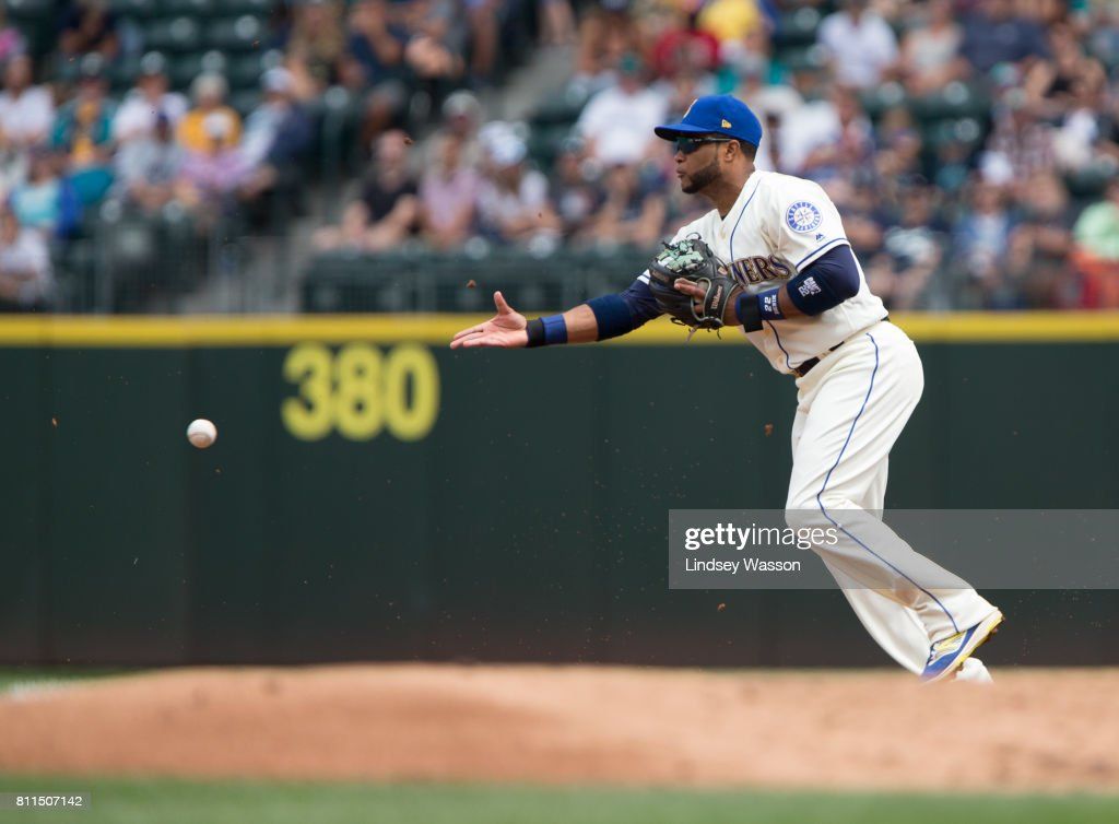 Robinson Cano #22 of the Seattle Mariners tries to throw out Khris Davis #2 of the Oakland Athletics at second base but can't make it after his fielding error in the second inning at Safeco Field on July 9, 2017 in Seattle, Washington.