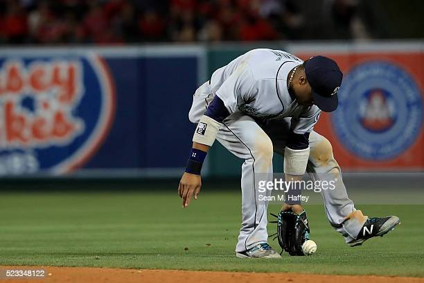 Robinson Cano of the the Seattle Mariners bobbles a grounder hits a by Yunel Escobar of the the Los Angeles Angels of Anaheim during the eighth...