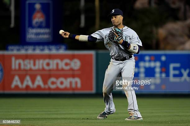 Robinson Cano of the the Seattle Mariners throws to first base during a baseball game between the Los Angeles Angels of Anaheim and the Seattle...