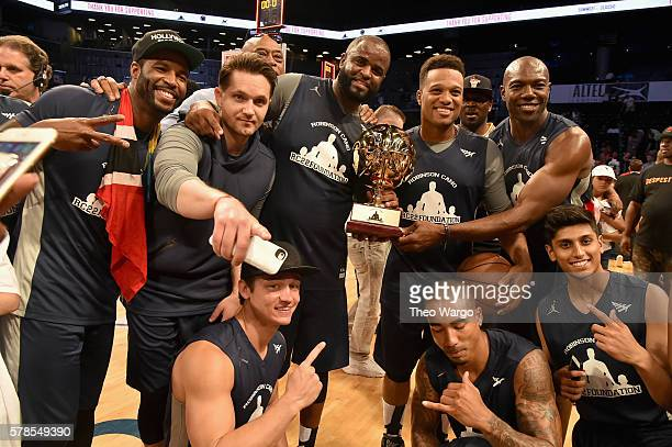 Robinson Cano poses with trophy and winning team at the Roc Nation Summer Classic Charity Basketball Tournament at Barclays Center of Brooklyn on...