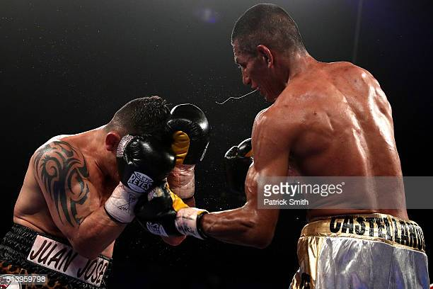 Robinson Castellanos exchanges punches with Oscar Escandon in their WBC interim featherweight title match at the DC Armory on March 5, 2016 in...