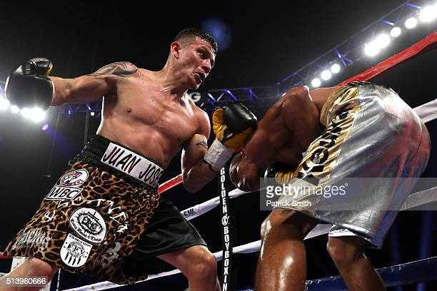 Robinson Castellanos takes a punch from Oscar Escandon in their WBC interim featherweight title match at the DC Armory on March 5, 2016 in...