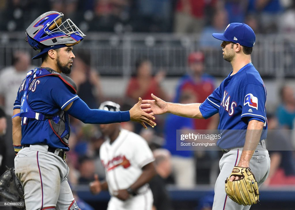Robinson Chirinos #61 and Nick Martinez #22 the Texas Rangers celebrate after the game against the Atlanta Braves at SunTrust Park on September 4, 2017 in Atlanta, Georgia.