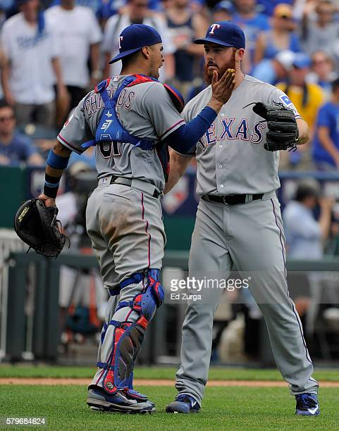Robinson Chirinos and Sam Dyson of the Texas Rangers celebrate a 21 win over the Kansas City Royals at Kauffman Stadium on July 24 2016 in Kansas...