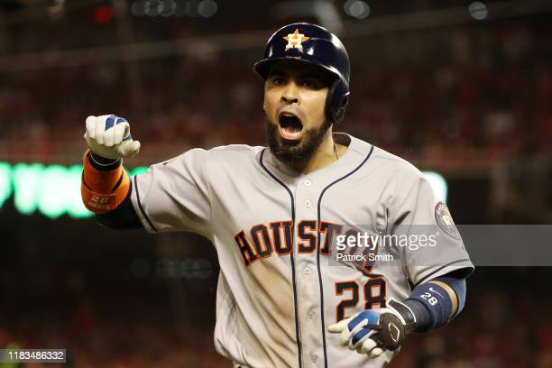 Robinson Chirinos of the Houston Astros celebrates his solo home run against the Washington Nationals during the sixth inning in Game Three of the...