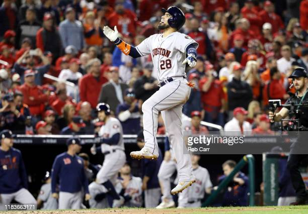 Robinson Chirinos of the Houston Astros celebrates his tworun home run against the Washington Nationals during the fourth inning in Game Four of the...