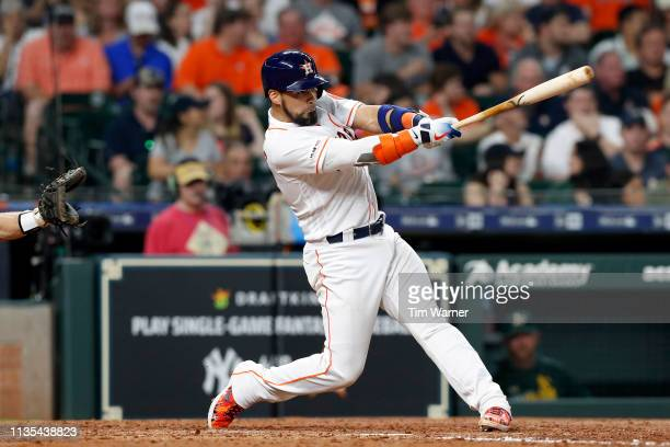 Robinson Chirinos of the Houston Astros hits a homerun in the sixth inning against the Oakland Athletics at Minute Maid Park on April 6 2019 in...
