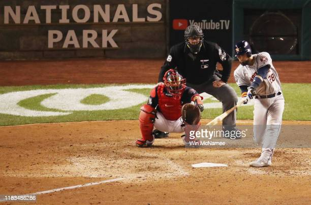 Robinson Chirinos of the Houston Astros hits a solo home run against the Washington Nationals during the sixth inning in Game Three of the 2019 World...