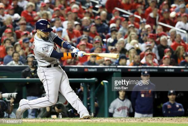 Robinson Chirinos of the Houston Astros hits a tworun home run against the Washington Nationals during the fourth inning in Game Four of the 2019...