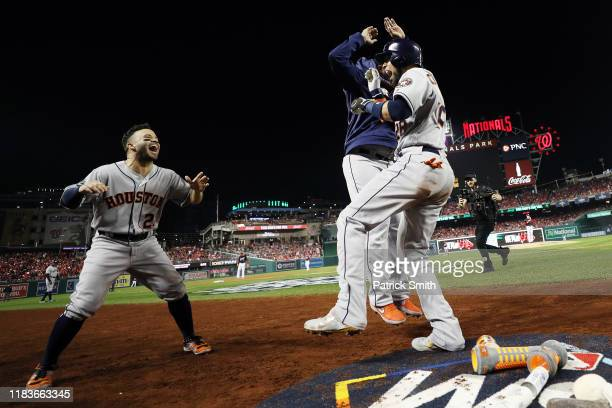 Robinson Chirinos of the Houston Astros is congratulated by his teammates after hitting a tworun home run against the Washington Nationals during the...