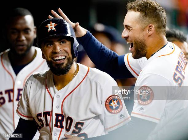 Robinson Chirinos of the Houston Astros receives congratulations from George Springer after hitting a home run in the seventh inning against the...