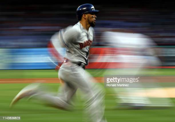 Robinson Chirinos of the Houston Astros scores a run against the Texas Rangers in the second inning at Globe Life Park in Arlington on April 19 2019...