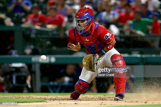 Robinson Chirinos of the Texas Rangers attempts to make a play at home in the eighth inning during a game against the Minnesota Twins at Globe Life...